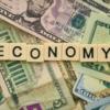 お札の上に置かれたeconomyの文字